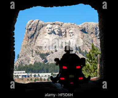 Mount Rushmore. A motorcycle riding through a tunnel on US-16A Scenic Byway towards Mount Rushmore National Memorial - Stock Photo