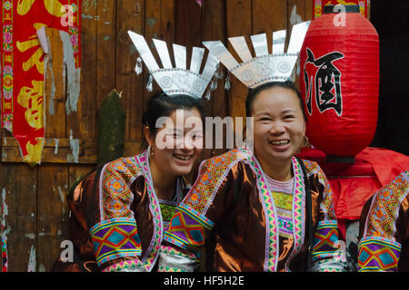 Dong girls in traditional clothing, Chengyang, Sanjiang, Guangxi Province, China - Stock Photo