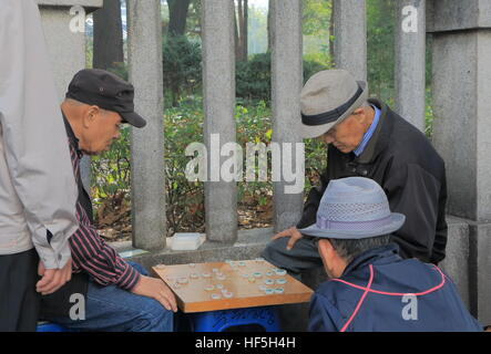 People play traditional board game in Seoul South Korea. - Stock Photo