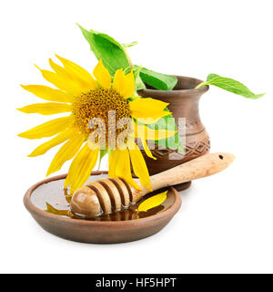 clay dish with honey drizzler and flowers sunflowers isolated on white background - Stock Photo