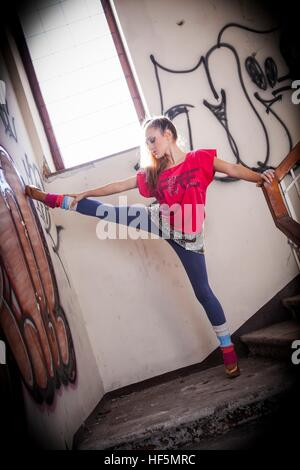 High-kick pose teen girl being inside indoors interior wellbeing human being - Stock Photo