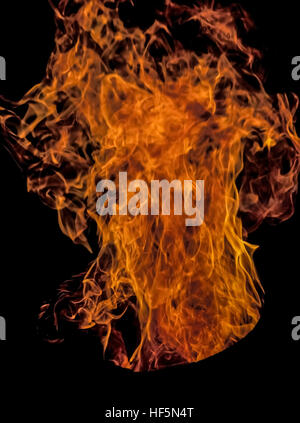 Colorful orange and yellow flames dance skyward from a blazing fire in a barrel. - Stock Photo
