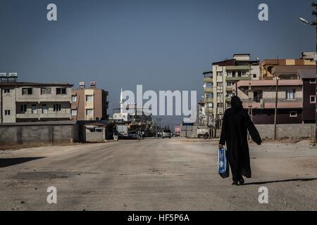 Turkey - Reyhanli - Smugglers' Town -  22/09/2015  -  Turkey / Hatay / Reyhanli  -  A veiled woman walks along main - Stock Photo
