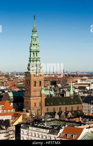 Denmark, Copenhagen, tower and spire of old Saint Nicolas' church, now St Nicolaj Kunsthal Contemporary Art Centre - Stock Photo