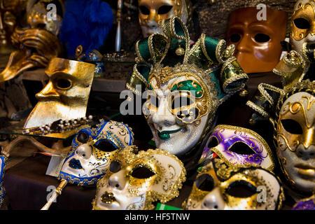 Denmark, Copenhagen, Højbro Plads, Christmas Market, Venitian Carnival masks for sale on Italian produce stall - Stock Photo