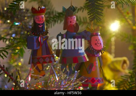 Three kings/wise men decorations on a Christmas tree - Stock Photo