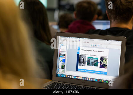 Higher Education in the UK: Aberystwyth University students using their laptop computers   in a lecture on the campus - Stock Photo