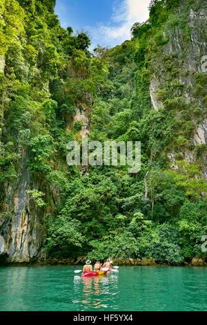 Kyaking at Ko Talabeng Island, Krabi Province, Thailand - Stock Photo