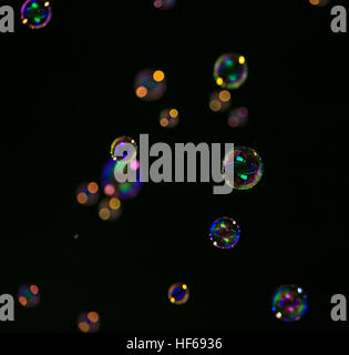 Lot of soap bubbles on a dark background - Stock Photo