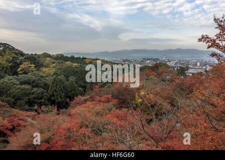 View of Kyoto over the red maples of Otowa-san, Kiyomizu-dera Buddhist  temple, Kyoto, Japan - Stock Photo