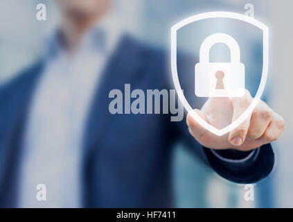 Person touching a shield with a lock symbol, concept about security, cybersecurity and protection against dangers - Stock Photo