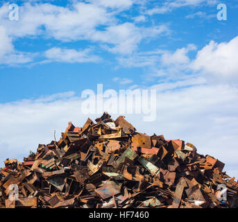 Scrap metal from ship broken up for recycling in port scrapyard in Spain - Stock Photo