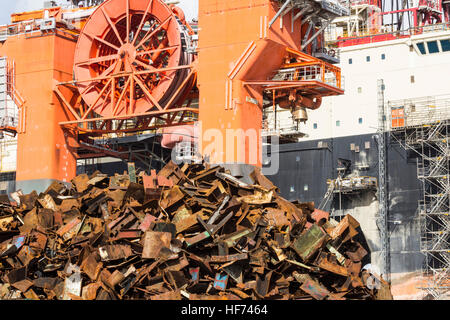 Scrap metal from ship broken up for recycling in port scrapyard in Spain. - Stock Photo