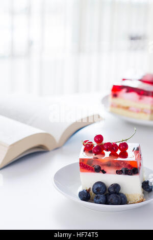 Time for something sweet. Cake with jelly on the table. - Stock Photo