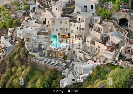 OIA, SANTORINI, GREECE - OCT. 2015: The famous Cycladic Architecture cave houses which are used as motels and inns - Stock Photo