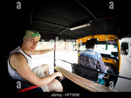 Transporting us in the classic tuk tuk through the streets of Jaisalmer. - Stock Photo
