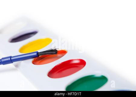 Watercolor paint set with brush isolated over white. - Stock Photo