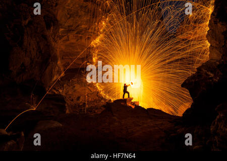 Showers of hot glowing sparks from spinning steel wool. - Stock Photo