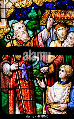 Stained Glass window depicting Moses in the Cathedral of Saint Bavo in Ghent, Flanders, Belgium. - Stock Photo