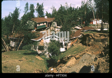 Result of earthquake of March 27, 1964. Upheaval of soil and destroyed houses; near Anchorage, Alaska. - Stock Photo