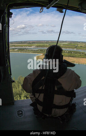 U.S. Customs and Border Protection, Air and Marine Operations in flight patrolling over Miami waters.  AMO flight - Stock Photo