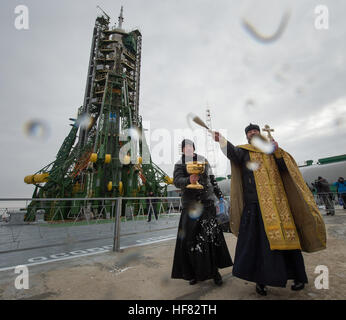 An Orthodox Priest blesses members of the media after he blessed the Soyuz rocket at the Baikonur Cosmodrome Launch - Stock Photo