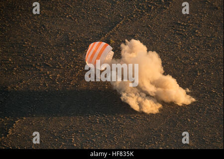 The Soyuz TMA-20M spacecraft is seen as it lands with Expedition 48 crew members NASA astronaut Jeff Williams, Russian - Stock Photo
