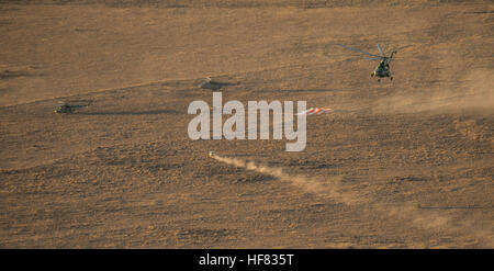 Russian Search and Rescue teams arrive at the Soyuz TMA-20M spacecraft shortly after it landed with Expedition 48 - Stock Photo