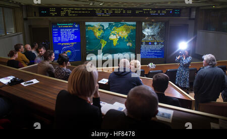 Friends and family members of the Soyuz MS-02 crew watch a live view of the International Space Station, as seen - Stock Photo