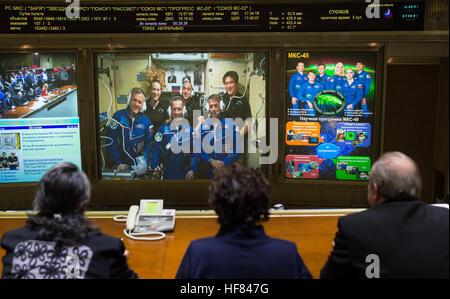 Expedition 49 Flight Engineers Andrey Borisenko of Roscosmos, front left, Sergey Ryzhikov of Roscosmos, front center, - Stock Photo