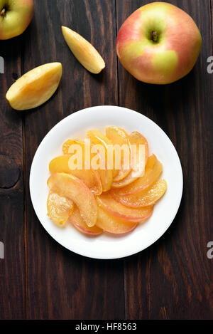 Caramelized apple slices on plate, top view - Stock Photo