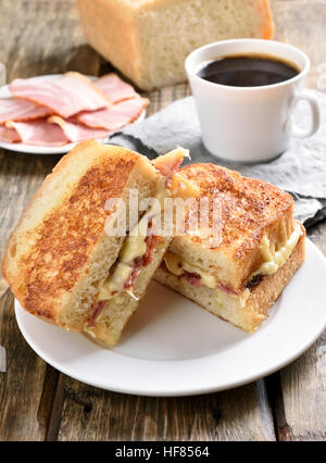 Grilled cheese sandwich for breakfast and cup of coffee - Stock Photo