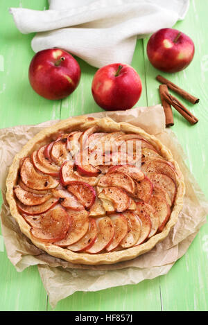 Fruit apple pie on baking paper - Stock Photo