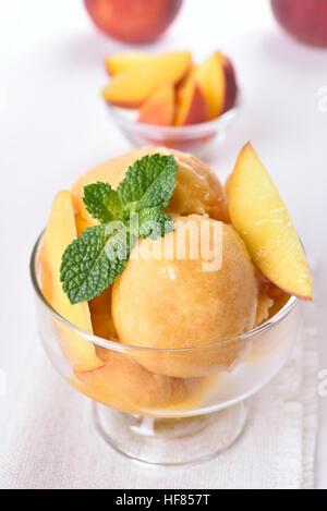 Apricot peach ice cream in glass bowl - Stock Photo