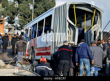 Tunis, Jebel Jalloud. 28th Dec, 2016. Tunisian security officers gather at the site of a collision, after a train - Stock Photo