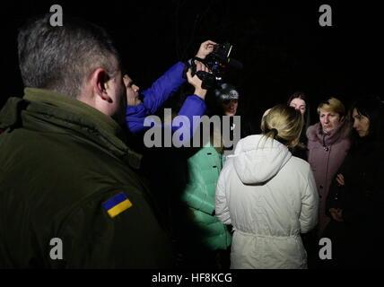 HORLIVKA, UKRAINE - DECEMBER 29, 2016: The Ukrainian Government hands over 15 war prisoners, 8 men and 7 women, - Stock Photo