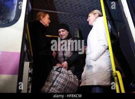 HORLIVKA, UKRAINE - DECEMBER 29, 2016: Olga Kobtseva (L), head of the working group on the exchange of prisoners - Stock Photo