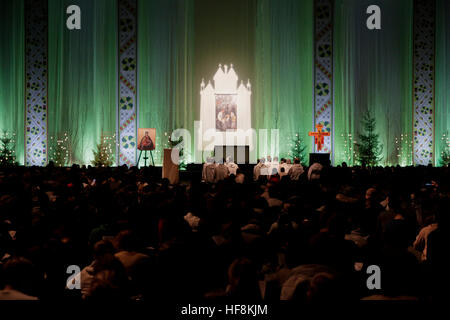 Latvia, Riga. 29th December 2016. The brothers of Taize sit in front of the altar among the young pilgrims. The - Stock Photo