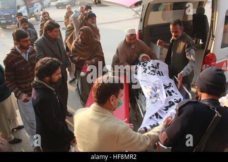 Abbottabad, Pakistan. 30th Dec, 2016. Local men Shifting Injured in hospital, at least 5 People Killed & 8 sustain - Stock Photo