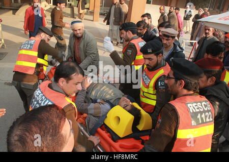 Abbottabad, Pakistan. 30th Dec, 2016. Rescue Workers Shifting Injured in hospital, at least 5 People Killed & 8 - Stock Photo