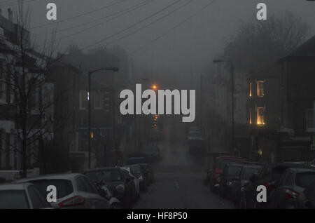 Wandsworth Common, London, UK. 30th December, 2016.  Heavy fog over the UK Credit: JOHNNY ARMSTEAD/Alamy Live News - Stock Photo