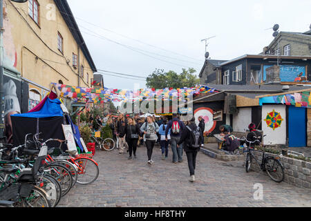 Copenhagen, Denmark - September 26, 2016: People on Pusher Street in the freetown district Christiania - Stock Photo