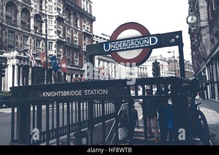 London,Uk - April 15, 2016: People at the entrance to underground, Knightsbridge Station in  London, England. - Stock Photo