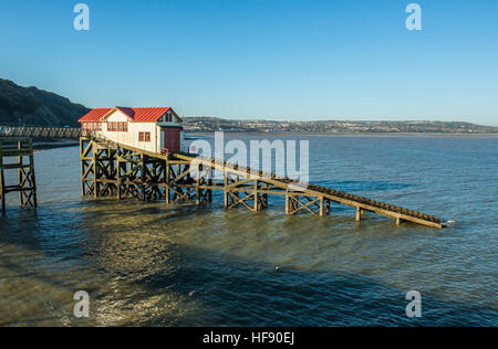 The old RNLI Lifeboat Station off the end of Mumbles Pier, Swansea, south Wales on a sunny winter day - Stock Photo