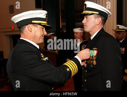 Cmdr. Brian L. Sittlow receives the Legion of Merit award before being relieved by Cmdr. Scott C. Luers  as commanding - Stock Photo