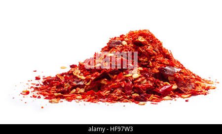 Pile of crushed red pepper (flakes, RPF), the dried and crushed cayennes with seeds. Clipping paths, shadow separated - Stock Photo