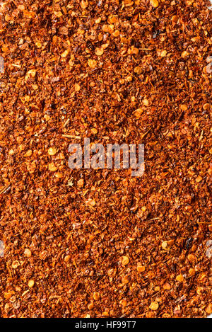 ground pepper grouped together to form a background - Stock Photo