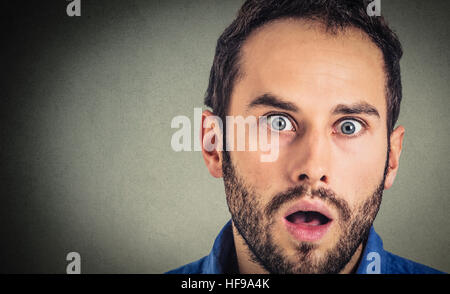 Astonished man. Closeup portrait guy looking surprised in full disbelief isolated on grey wall background. Human - Stock Photo