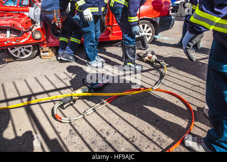 firemen during a car accident simulation Stock Photo: 129898347 - Alamy