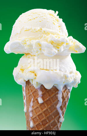 Two scoops of vanilla ice cream in a waffle cone - Stock Photo